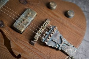 handmade guitar with brass covers and bridge