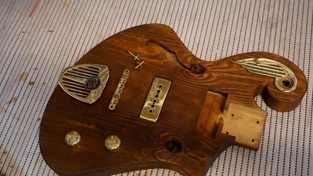 handmade guitar with custom brass hardware